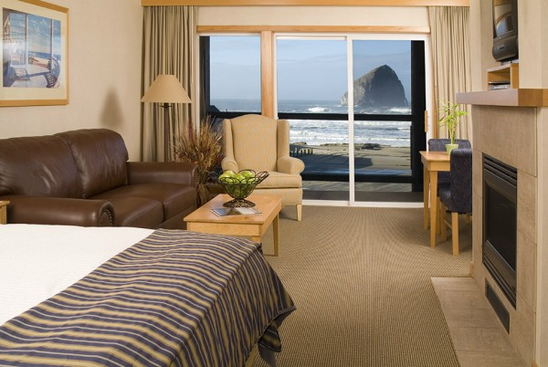 Inn At Cape Kiwanda Room With Bed And Haystack Rock Outside The Window